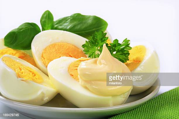 halves of hardboiled eggs on a plate - mayonnaise stock pictures, royalty-free photos & images