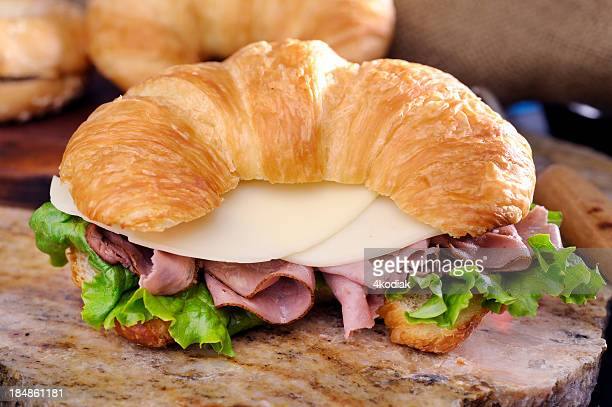 A ham and cheese sandwich on a croissant