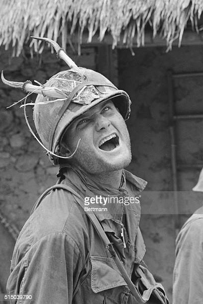 Ham Chu Lai South Vietnam With his stubble of beard horned helmet and acting ability this member of a Co 2/502 101st Airborne Division looks very...