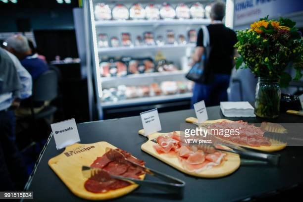 Ham is displayed to customers during The Summer Fancy Food Show at the Javits Center in the borough of Manhattan on July 02 2018 in New York The...