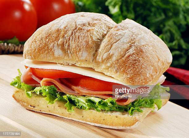 Ham lettuce tomato and provolone on a fresh baguette