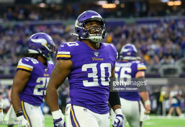 J Ham of the Minnesota Vikings celebrates after catching the ball for a first down in the second quarter of the game against the Detroit Lions at US...