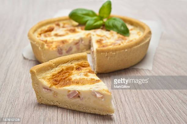 Ham quiche with a piece of the pie cut out