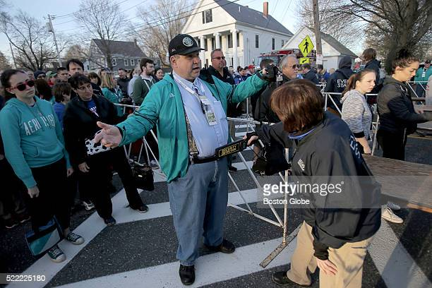 Ham radio volunteer James Bebarski gets screened before entering the start village before the running of the the 120th Boston Marathon on Monday...