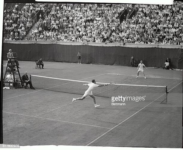 Ham Richardson is shown as he slammed a return to Lewis Hoad of Australia during their quarter final match in the National Tennis Championships today...