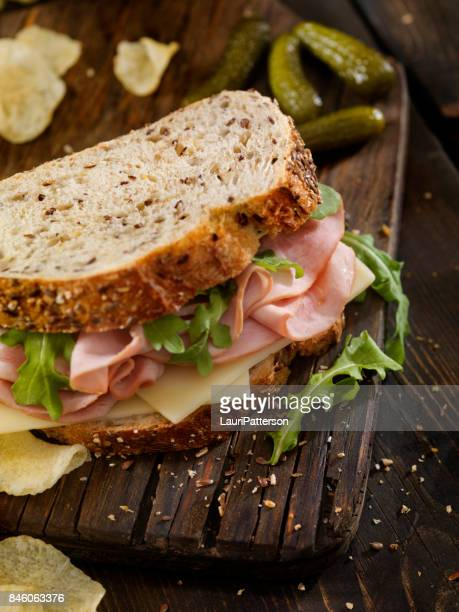 ham, swiss and arugula sandwich - smoked food stock photos and pictures