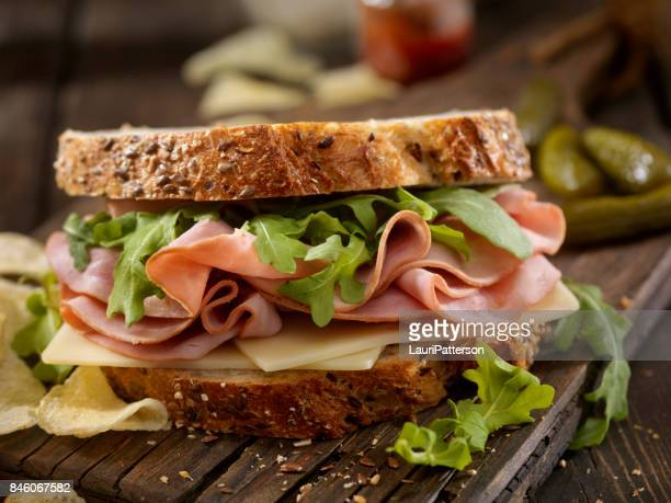 ham, swiss and arugula sandwich - ham stock pictures, royalty-free photos & images