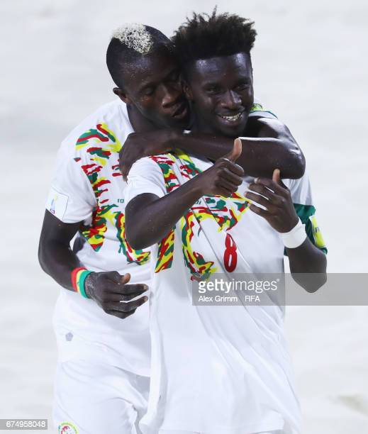 Hamad Diouf of Senegal celebrates a goal with team mate Ibrahima Balde during the FIFA Beach Soccer World Cup Bahamas 2017 group A match between...