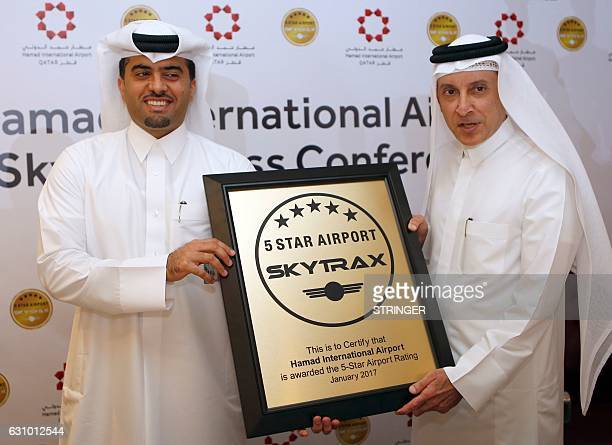 Hamad International Airport's chief operating officer Badr alMeer and Qatar Airways chief executive Akbar alBaker pose for a picture during a...