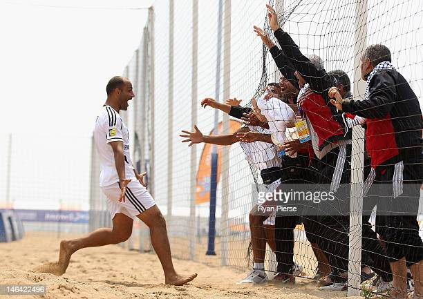 Hamada Eshbair celebrates a goal during the Men's Beach Soccer Preliminary match between Vietnam and Palestine on Day 0 of the 3rd Asian Beach Games...