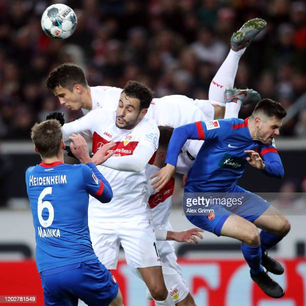 Hamadi Al Ghaddioui, Nathaniel Phillips and Marc-Oliver Kempf of Stuttgart are challenged by Patrick Mainka and Marnon Busch of Heidenheim during the...