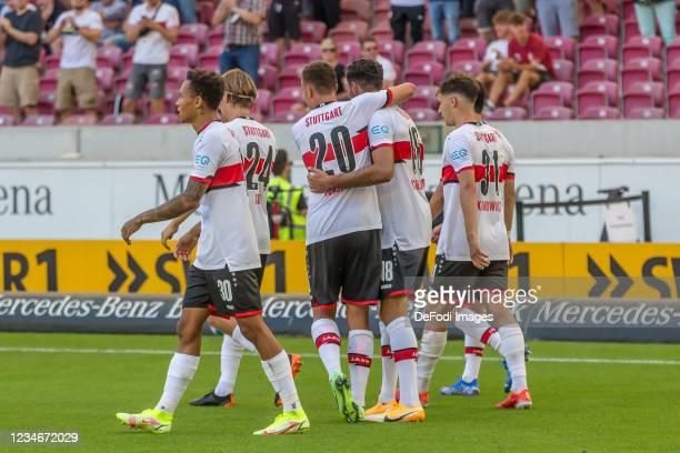 Hamadi Al Ghaddioui of VfB Stuttgart celebrates after scoring his team's fourth goal with teammates during the Bundesliga match between VfB Stuttgart...