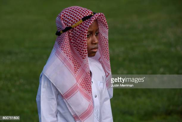 Hamadi Hamadi of Pittsburgh's North Side waits for prayer to begin during an Eid alFitr celebration marking the end of Ramadan on June 25 2017 in...