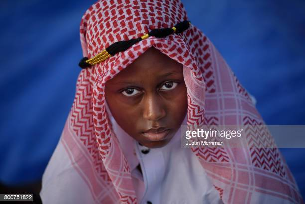 Hamadi Hamadi of Pittsburgh's North Side waits for the prayer to begin during an Eid alFitr celebration marking the end of Ramadan on June 25 2017 in...