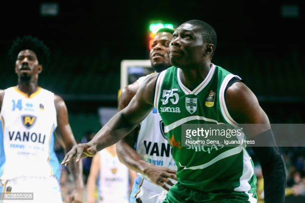 Hamady Ndiaye of Sidigas competes with Kelvin Martin and Henry Sims of Vanoli during the match quarter final of Coppa Italia between Scandone Sidigas...
