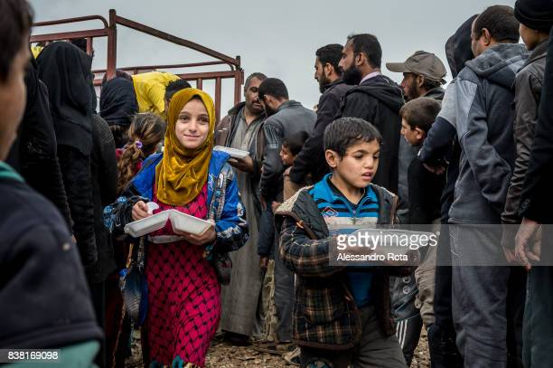 IRAQ Hamam Al Alil Refugee camp in Mosul Province 13 Mar 2017 People gather for food distribution