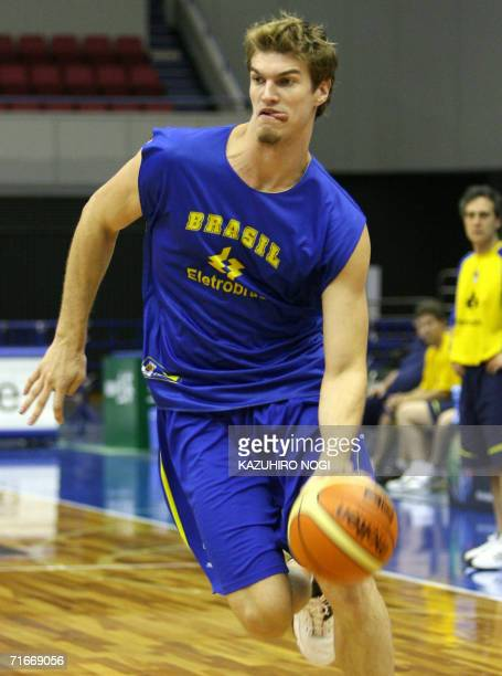 Brazilian basketball team power forward player Tiago Splitter dribbles the during an official practice session ahead of the World Basketball...