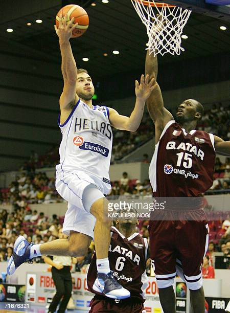 Greek point guard Vassilis Spanoulis attempts a basket as Omer Abgader Salem tries to block during their Group C opening match at the World...
