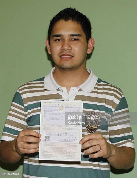 Hamamatsu Japan Lucas Futenma holds a certificate of eligibility for residence status for his wife Giullyane Futenma in Hamamatsu Shizuoka Prefecture...