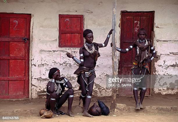 Hamar women wearing traditional decorations Turmi Ethiopia