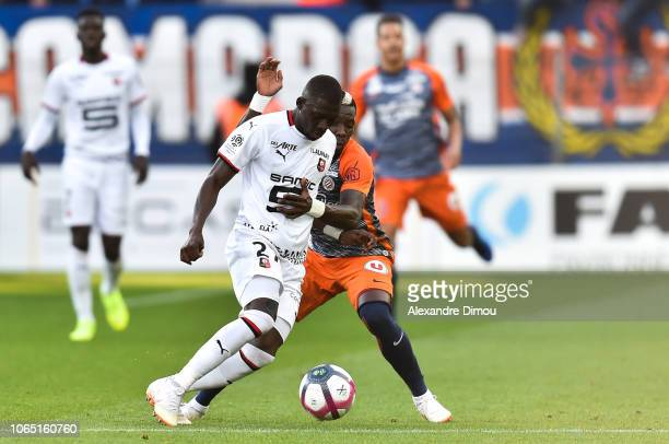 Hamari Traore of Rennes and Ambroise Oyongo of Montpellier during the Ligue 1 match between Montpellier and Rennes at Stade de la Mosson on November...