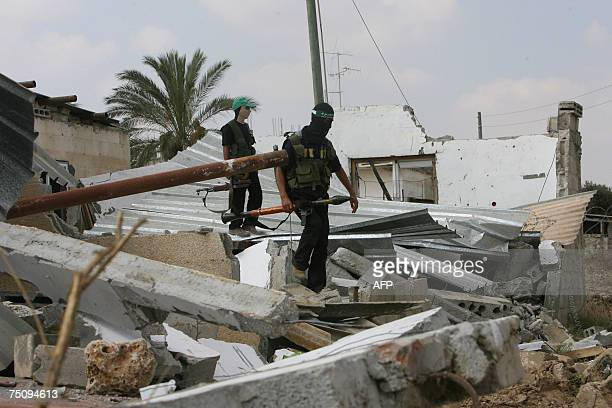Hamas fighters inspect a destroyed former preventative security building whose staff are manily Fatah party members in the alBureij refugee camp in...