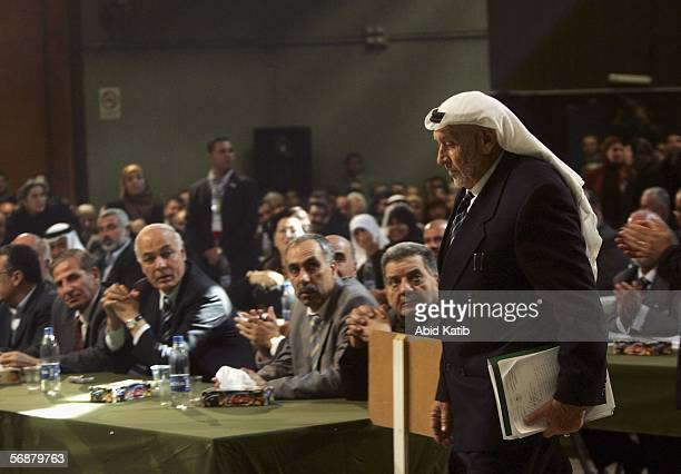 Hamas Leader and the oldest palestinian parliament member AbdelFatah Dokhan walks as he arrives to attend the inaugural parliament session on...