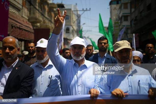 TOPSHOT Hamas leader Ismail Haniya and spokesman Fawzi Barhoum attend a protests in Gaza City on July 22 against new Israeli security measures...