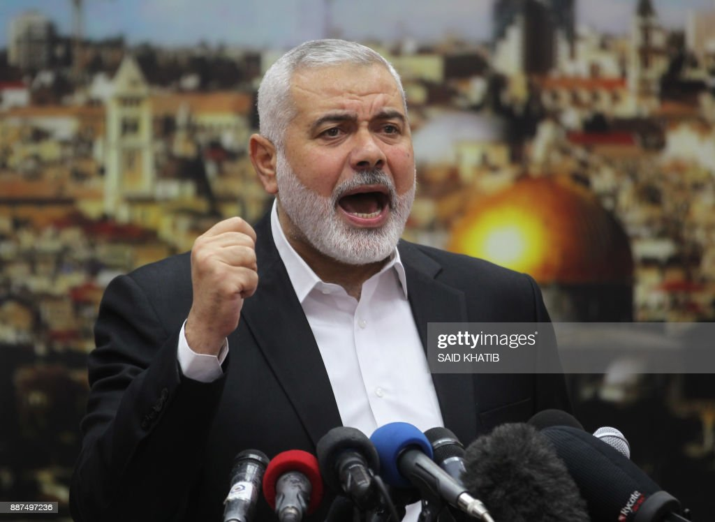 Hamas leader Ismail Haniya gestures as he delivers a speech over US President Donald Trump's decision to recognise Jerusalem as the capital of Israel, in Gaza City on December 7, 2017. Haniya called for a new Palestinian intifada, or uprising. This Zionist policy supported by the US cannot be confronted unless we ignite a new intifada,' the head of the armed Palestinian Islamist movement that runs the Gaza Strip said in a speech. /