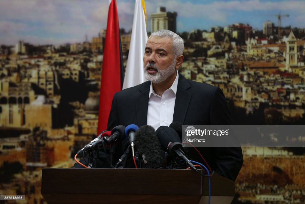 "Hamas leader Ismail Haniya gestures as he delivers a speech over US President Donald Trump's decision to recognise Jerusalem as the capital of Israel, in Gaza City on December 7, 2017. Haniya called for a new Palestinian intifada, or uprising. This Zionist policy supported by the US cannot be confronted unless we ignite a new intifada,"" the head of the armed Palestinian Islamist movement that runs the Gaza Strip said in a speech."