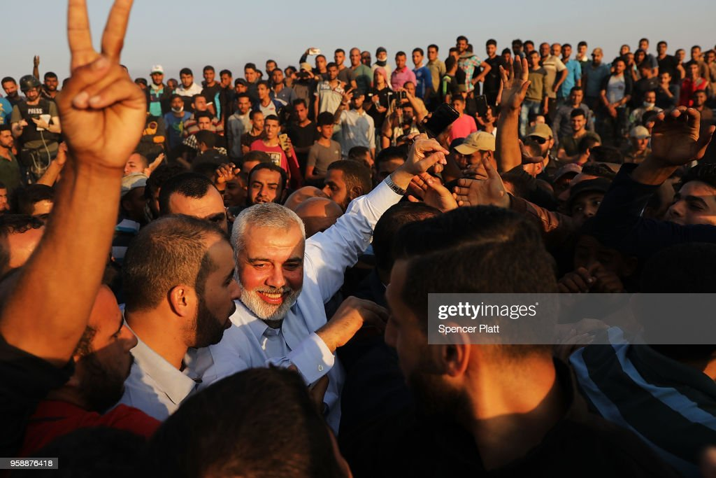 Hamas leader Ismail Haniya greets protesters at the border fence with Israel on May 15, 2018 in Gaza City, Gaza. Israeli soldiers killed over 50 Palestinians and wounded over a thousand as demonstrations on the Gaza-Israel border coincided with the controversial opening of the U.S. Embassy in Jerusalem yesterday. This marks the deadliest day of violence in Gaza since 2014. Gaza's Hamas rulers have vowed that the marches will continue until the decade-old Israeli blockade of the territory is lifted.