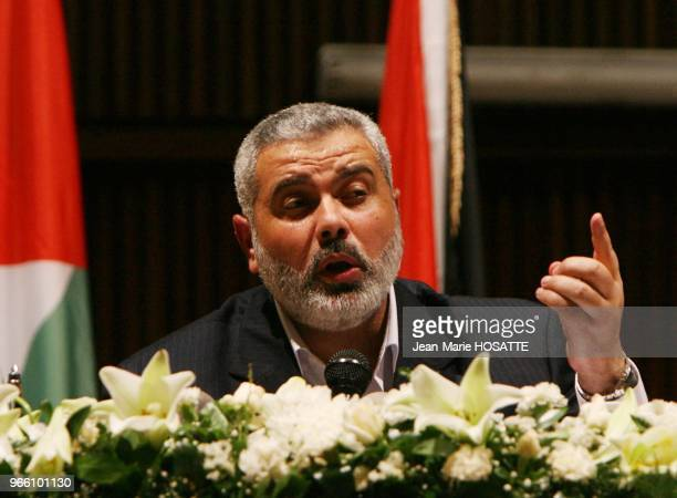 Hamas leader Ismail Haniyeh prime minister of the Palestinian government dismissed by President Mahmoud Abbas waves before giving his speech in Gaza...