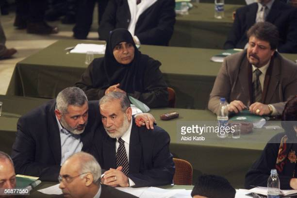 Hamas leader Ismail Haniyeh talks to Ahmed Bahar during the inaugural parliament session on February 2006 in Gaza City Gaza Strip The inaugural...