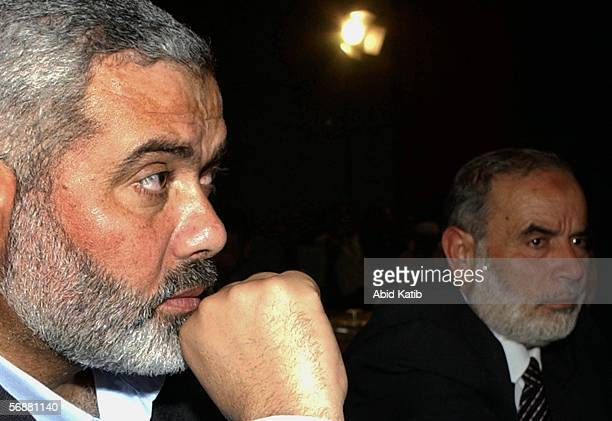 Hamas leaders Ismail Haniyeh and Ahmed Bahar attend the inaugural parliament session on February 18 2006 in Gaza City Gaza Strip The inaugural...