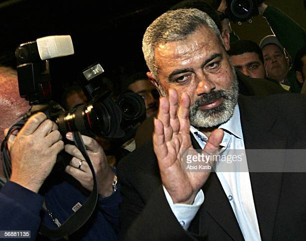 Hamas leaders Ismail Haniyeh attends the inaugural parliament session on February 18 2006 in Gaza City Gaza Strip The inaugural session of the new...