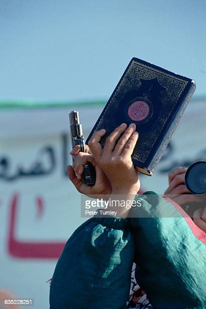 Hamas Member Holding Gun and Koran