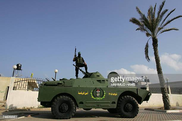 Hamas militant stands on top of an armed vehicle parked outside Palestinian leader Mahmud Abbas' office in Gaza City 15 June 2007 Hamas seized full...