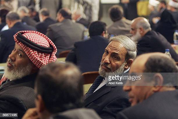 Hamas MP Mahmud Zahar looks over as he sits during the inaugural parliament session on February 2006 in Gaza City Gaza Strip The inaugural session of...