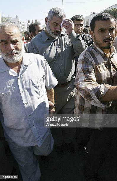 Hamas official Ismael Hanea walks with mourners as they carry the body of Adnan alGhoul a senior member of the Hamas militant group and a master...