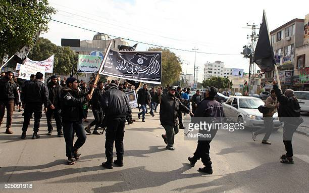 Hamas police push back Palestinian Salafists during a protest against satirical French weekly magazine Charlie Hebdo's cartoons of the Prophet...