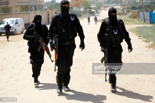 Hamas policemen carry out a raid in Nuseirat south of Gaza City on March 22 that resulted in the arrest of a suspect in a recent bomb attack against...