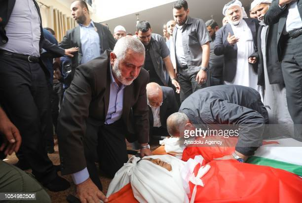 Hamas political chief Ismail Haniyeh mourn for three children aged between 12 and 14 who were killed in the Israeli airstrike during his funeral...