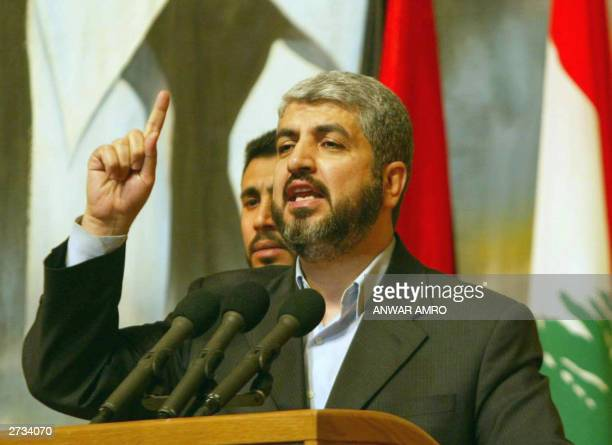 Hamas political leader Khaled Mashaal delivers a speech 16 November 2003 during a ceremony in Beirut to mark 33 years since deceased alAssad swept to...