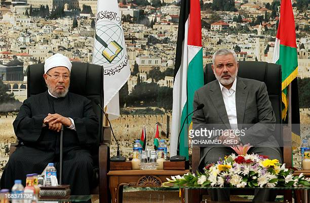 Hamas Prime Minister Ismail Haniyeh meets with Egyptian Cleric and chairman of the International Union of Muslim Scholars Sheikh Yusuf alQaradawi...