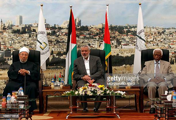 Hamas Prime Minister Ismail Haniyeh meets with Egyptian Cleric and chairman of the International Union of Muslim Scholars Sheikh Yusuf alQaradawi and...