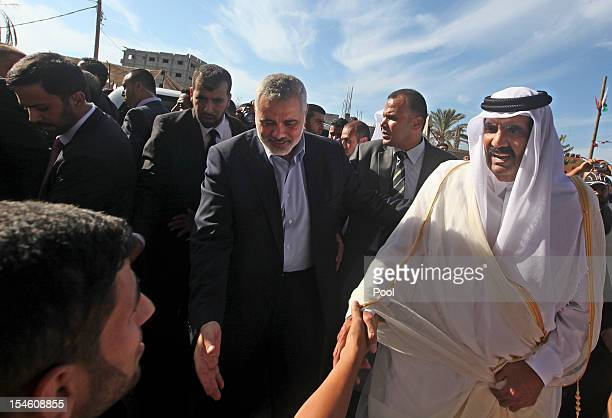 Hamas Prime Minister Ismail Haniyeh of the Palestinian National Authority and the Emir of Qatar Sheikh Hamad bin Khalifa alThani great locals as they...