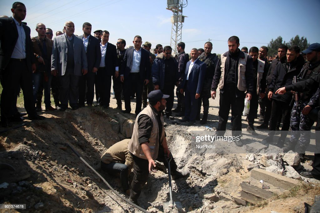 Hamas security services personnel inspect the site of a Tuesday explosion that occurred as the convoy of Palestinian Prime Minister Rami Hamdallah entered Gaza through the Erez crossing with Israel, on the main road in Beit Hanoun, Gaza Strip, Tuesday, March 13, 2018.The Fatah party of the prime minister called the explosion an assassination attempt and blamed Gaza militants. Hamdallah was unharmed and went on to inaugurate a long-awaited sewage plant project in the northern part of the strip.