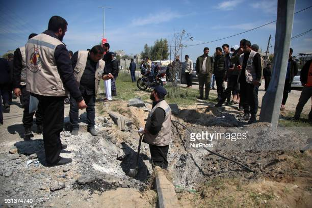 Hamas security services personnel inspect the site of a Tuesday explosion that occurred as the convoy of Palestinian Prime Minister Rami Hamdallah...