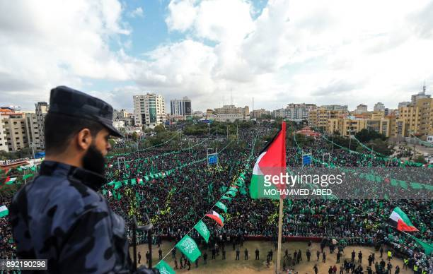 TOPSHOT Hamas supporters take part in a rally marking the 30th anniversary of the founding of the Islamist movement in Gaza City on December 14 2017...