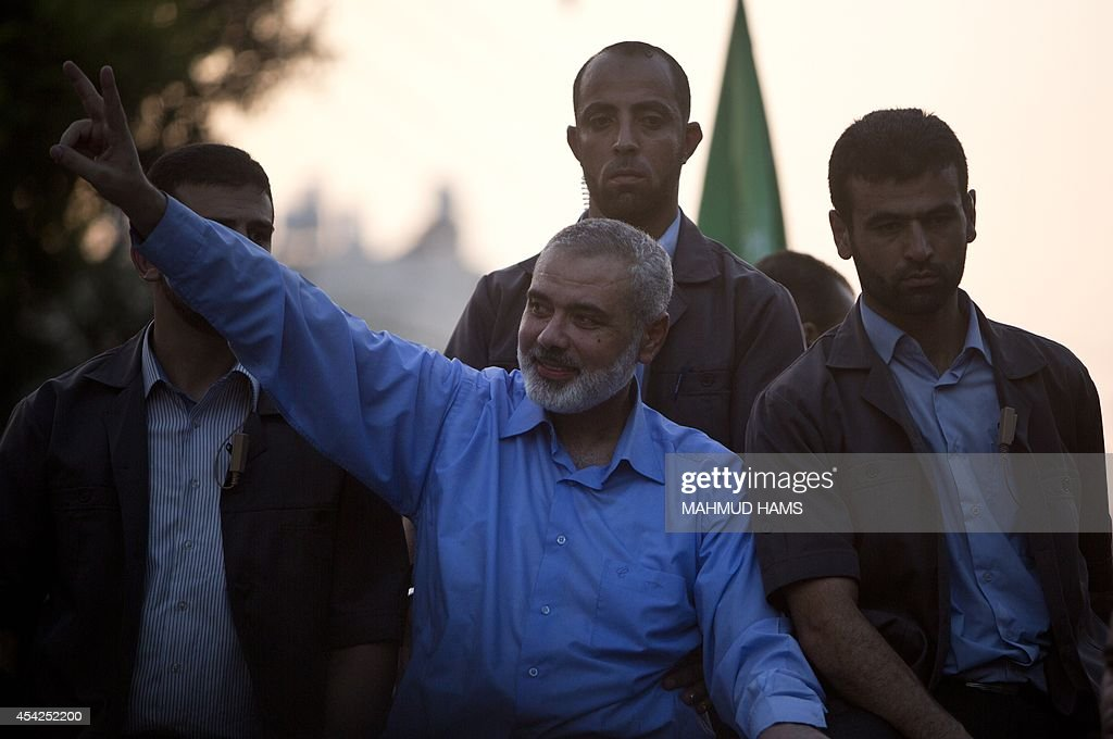 Hamas top leader in the Gaza Strip Ismail Haniya (C) waves to the crowd during a rally in Gaza City on August 27, 2014, following a deal hailed by Israel and the Islamist movement as 'victory' in the 50-day war. The agreement, effective from 1600 GMT on August 26, saw the warring sides agree to a 'permanent' ceasefire which Israel said would not be limited by time, in a move hailed by Washington, the United Nations and top world diplomats.